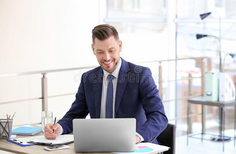 Consultant working at table stock photo