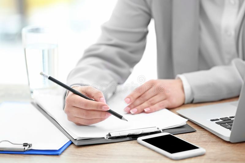 Consultant working at table in office, royalty free stock image