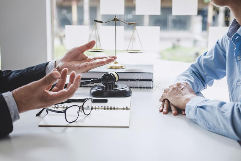 Consultation and conference of Male lawyers and professional businesswoman working and discussion having at law firm in office. royalty free stock photo