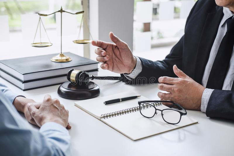 Consultation and conference of Male lawyers and professional businesswoman working and discussion having at law firm in office. royalty free stock photos