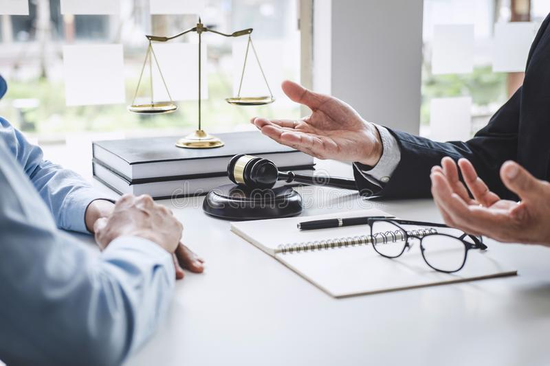 Consultation and conference of Male lawyers and professional businesswoman working and discussion having at law firm in office. stock photos