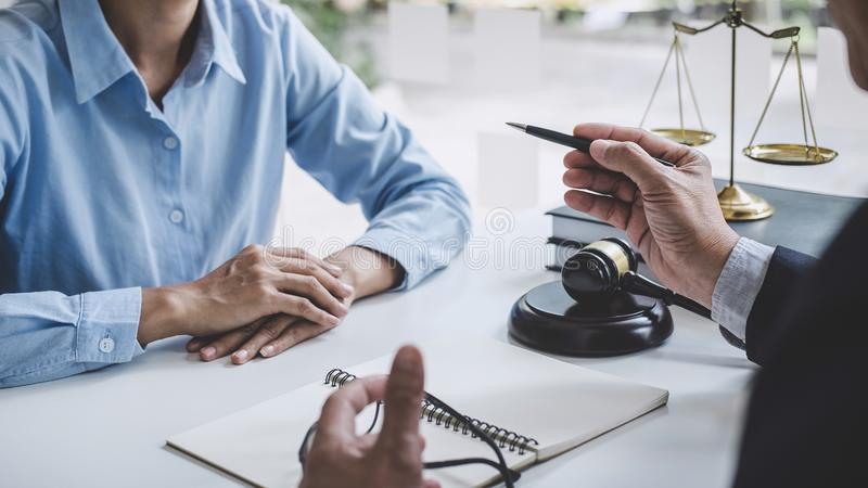 Consultation and conference of Male lawyers and professional businesswoman working and discussion having at law firm in office. stock photography