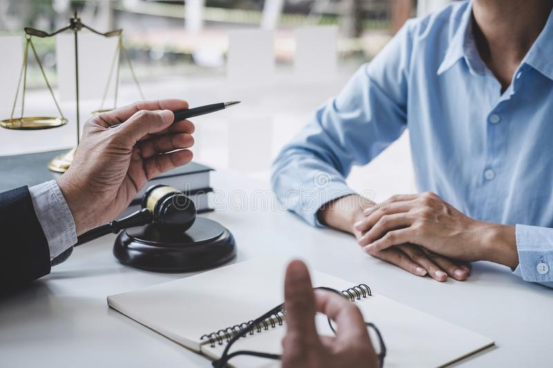 Consultation and conference of Male lawyers and professional businesswoman working and discussion having at law firm in office. royalty free stock image