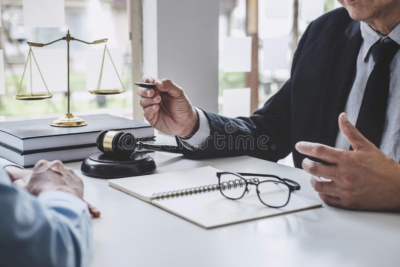 Consultation and conference of Male lawyers and professional businesswoman working and discussion having at law firm in office. stock images