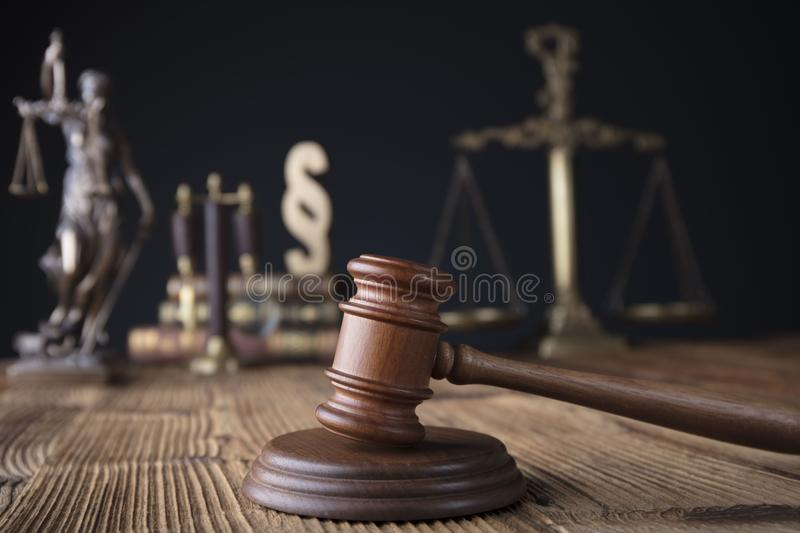 Lawyer, counselor office - law theme. Consultation with a lawyer concept. Gavel, scale on wooden table royalty free stock images