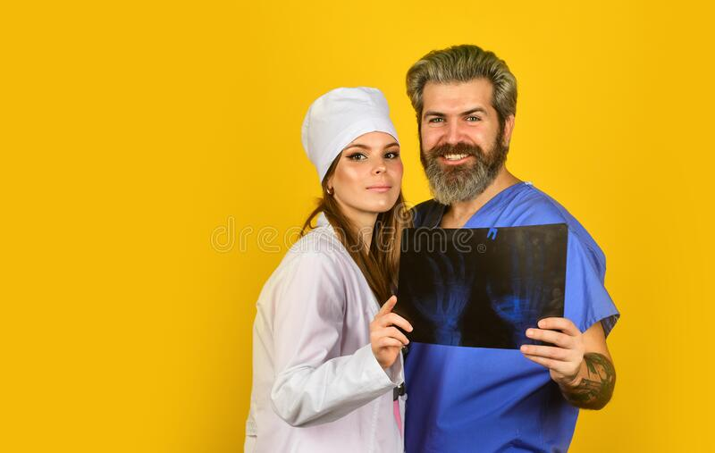 Consultation. x-ray diagnostics. radiographs tomography result. doctor and nurse need expert advice. study patient stock photography