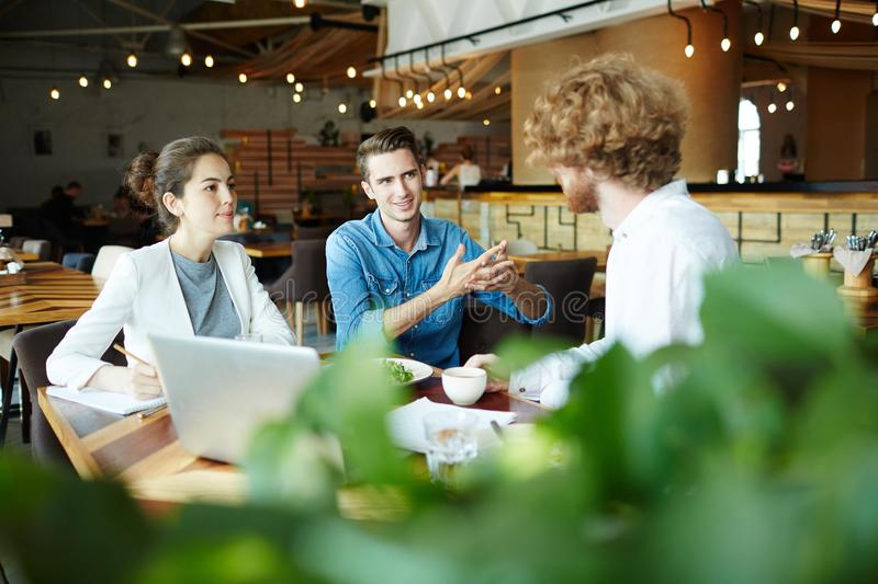 Consulting in cafe royalty free stock photo