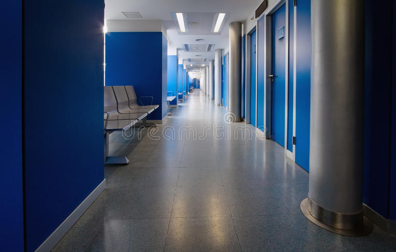 Consulting room of a hospital. Waiting room of a hospital with a long corridor royalty free stock images