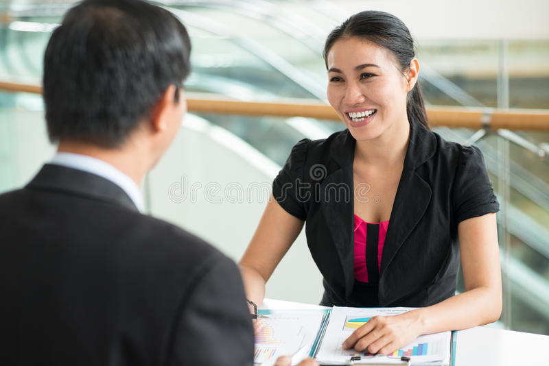 Consulting services. Cheerful businesswoman providing a male entrepreneur with consulting services stock photos