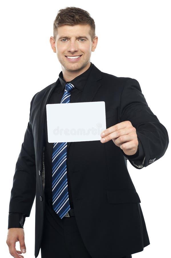 Consultor de asunto que presenta el cartel en blanco fotos de archivo libres de regalías
