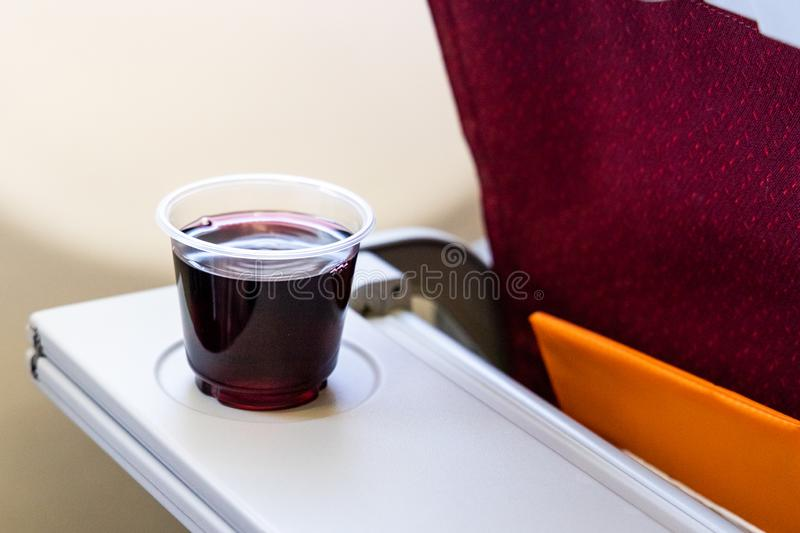 Consume too much red wine or alcohol in-flight causes dehydration stock photos