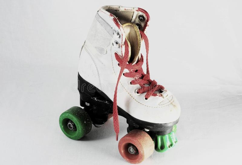 Consumed Roller Skate. Used Vintage Consumed Roller Skate on a White Background royalty free stock images