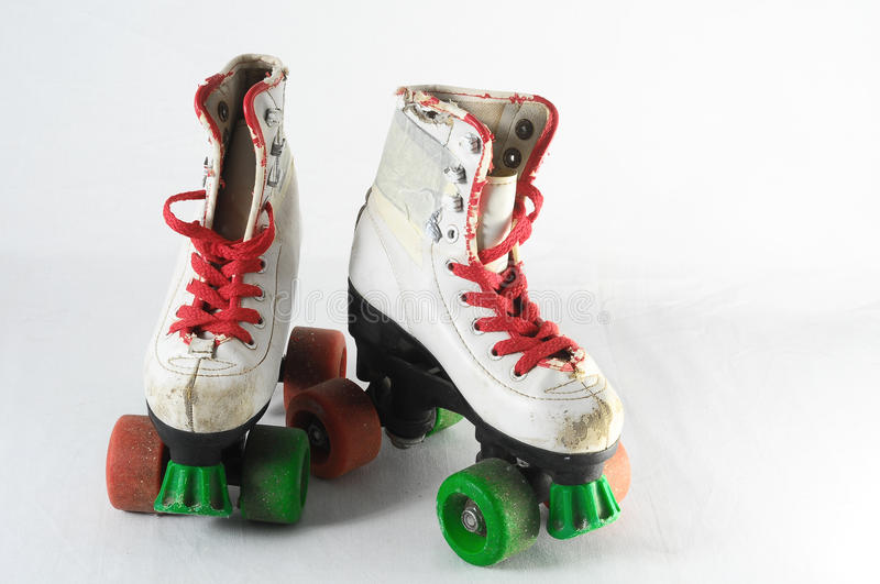Consumed Roller Skate. Used Vintage Consumed Roller Skate on a White Background royalty free stock photography