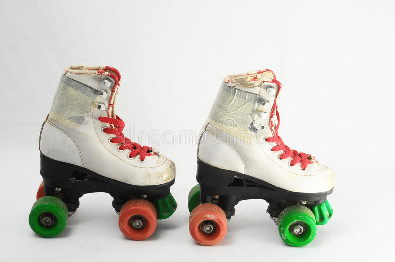 Consumed Roller Skate. Used Vintage Consumed Roller Skate on a White Background royalty free stock photo