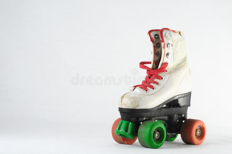 Consumed Roller Skate. Used Vintage Consumed Roller Skate on a White Background stock photo
