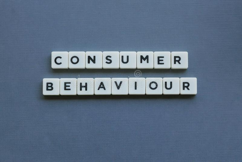 ' Consumer Behaviour ' word made of square letter word on grey background stock photography
