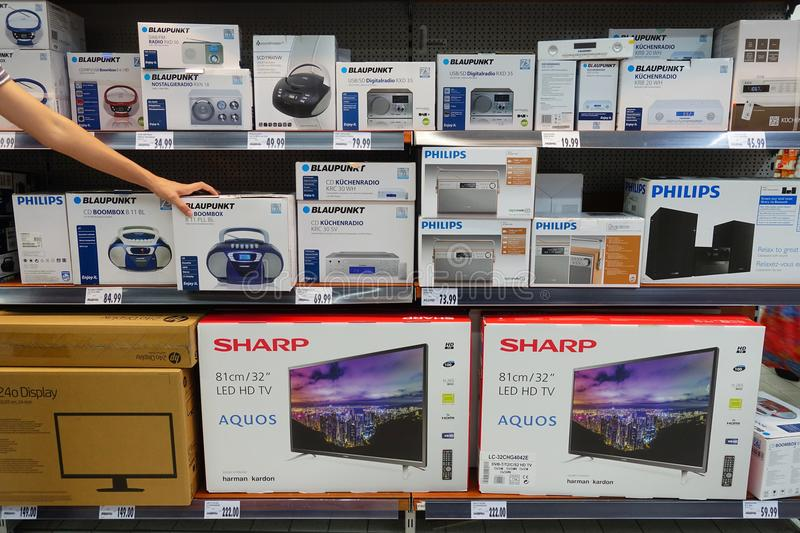 Consumer electronics in a store. GERMANY - AUGUST 2018: Electrical devices in a Kaufland supermarket. Blaupunkt was a German manufacturer of electronics royalty free stock images