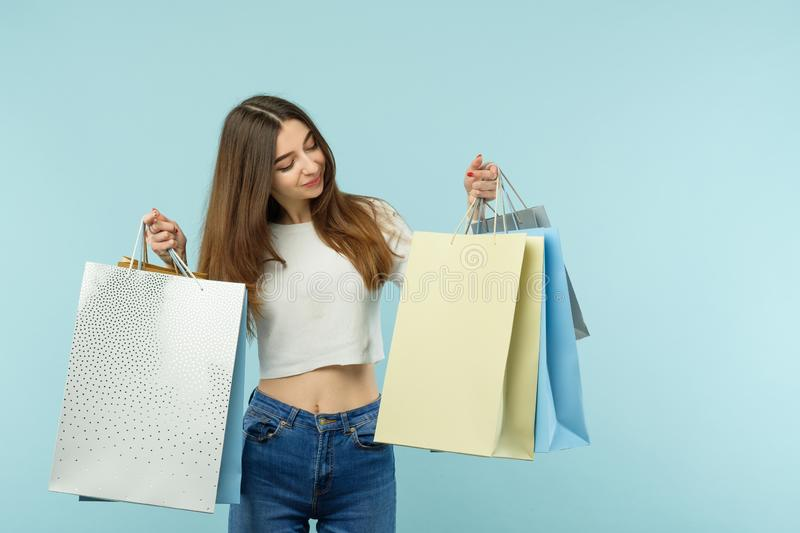 Consumerism attractive cute girl shopping bags royalty free stock photo