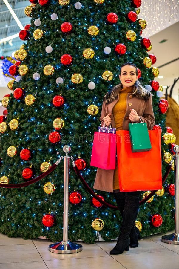 Consumerism, Christmas, shopping, lifestyle concept Woman in shopping. woman with shopping bags enjoying in shopping. . royalty free stock photography