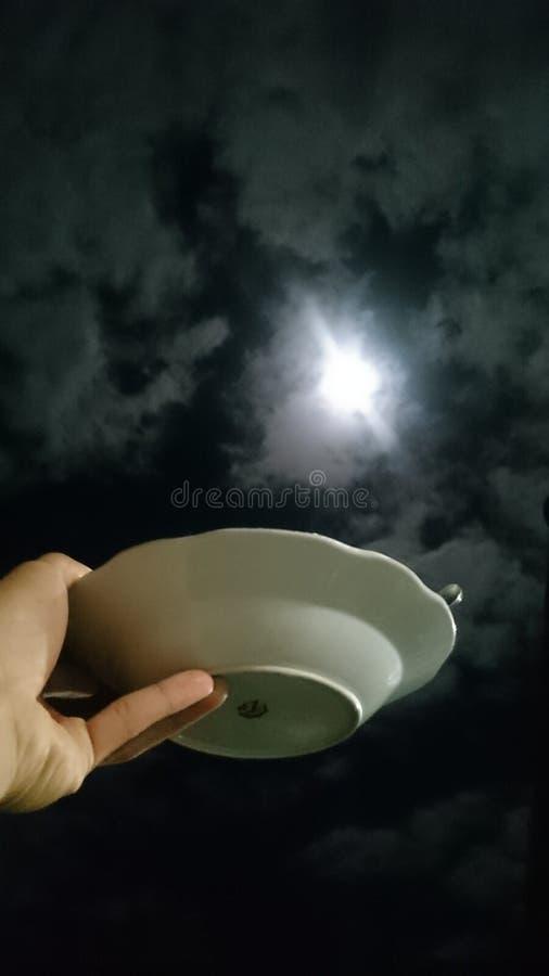 consumición con la luna imagenes de archivo