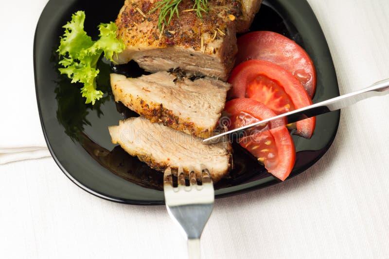 Consumición de la carne cocida imagen de archivo