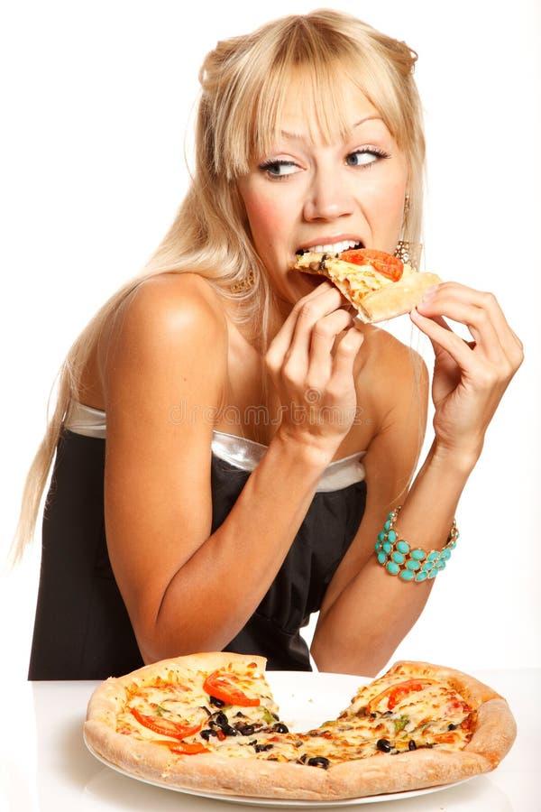 Consumición de la pizza fotografía de archivo