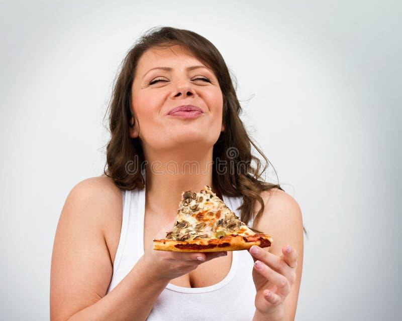 Consumición de la pizza fotos de archivo libres de regalías
