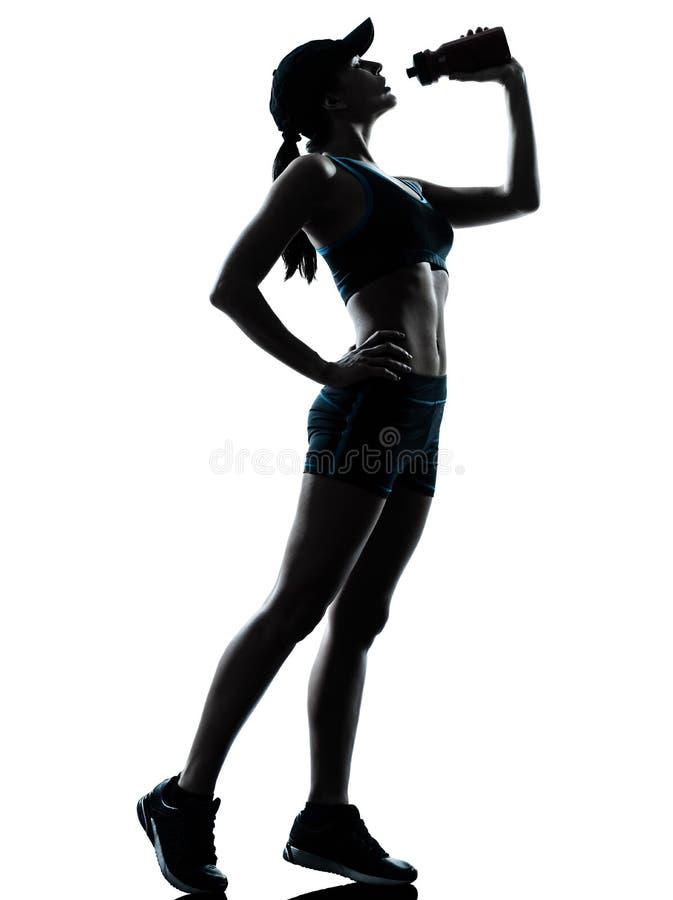Consumición del basculador del corredor de la mujer imagen de archivo