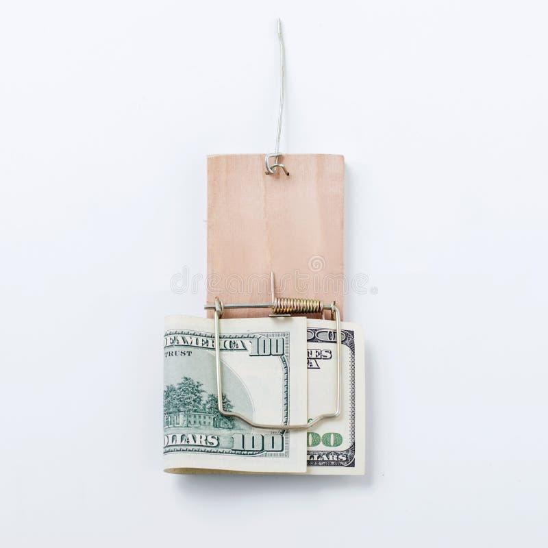 conta de Cem-dólar em uma armadilha fechado do rato imagens de stock
