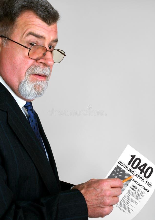 Contable del impuesto con la forma de impuesto 1040 foto de archivo libre de regalías