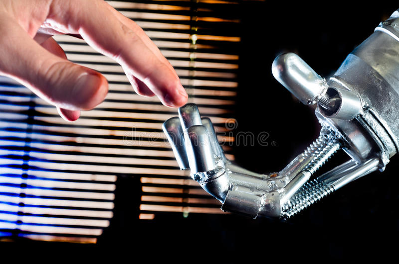 Contact between human and robot. On abstract background stock photo