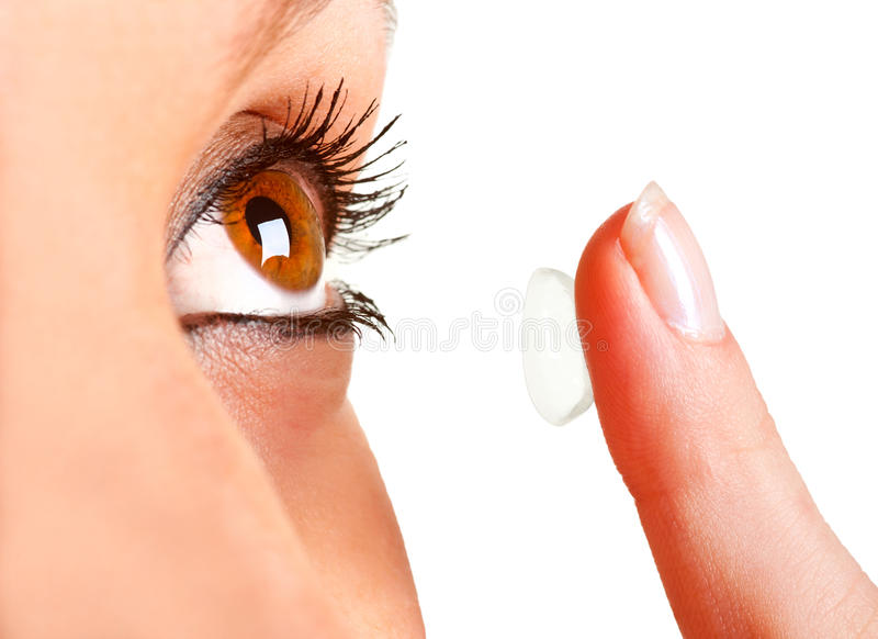 Contact Lens. Closeup of a woman inserting a contact lens in her eye stock photos