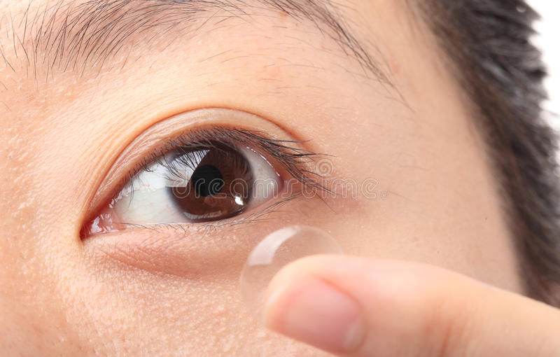 Contact lens. Woman with a contact lens stock photo