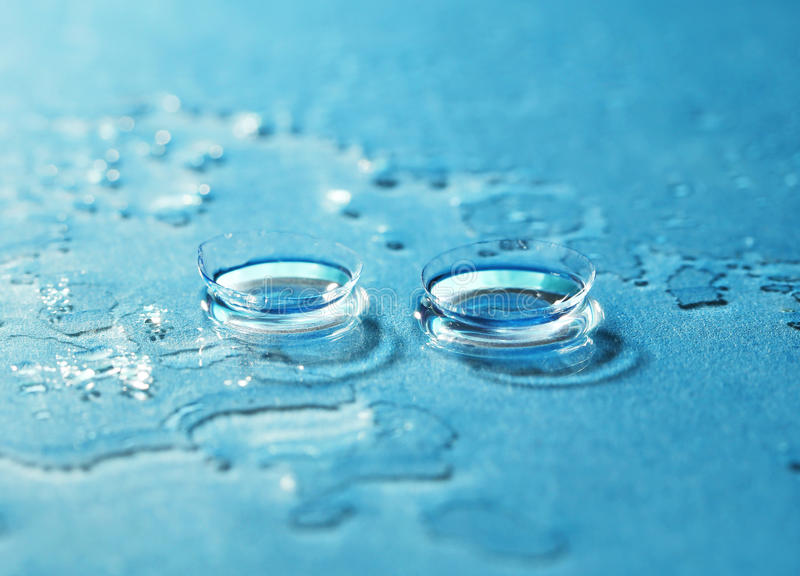Contact Lens. On the blue background stock photos