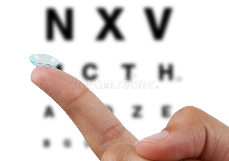 Contact lens on finger royalty free stock photography