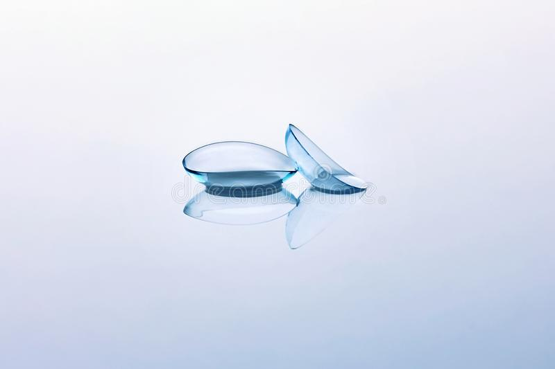 Contact lenses on light blue background. Eyewear, eyesight, eye care and health, ophthalmology and optometry royalty free stock photos