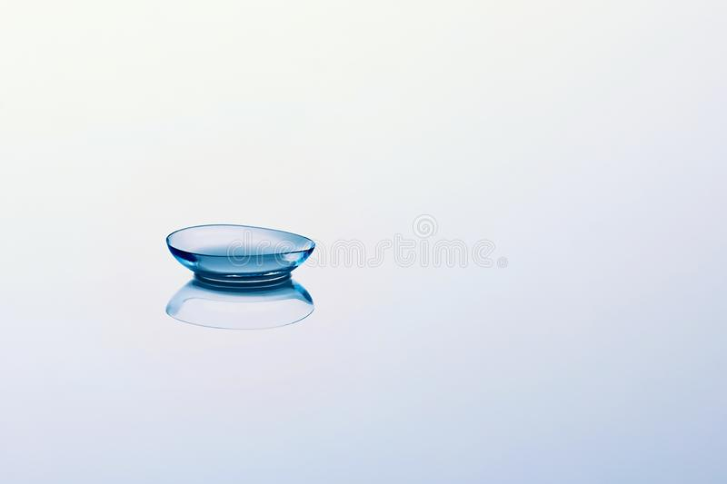 Contact lenses on light blue background. Eyewear, eyesight, eye care and health, ophthalmology and optometry stock photos