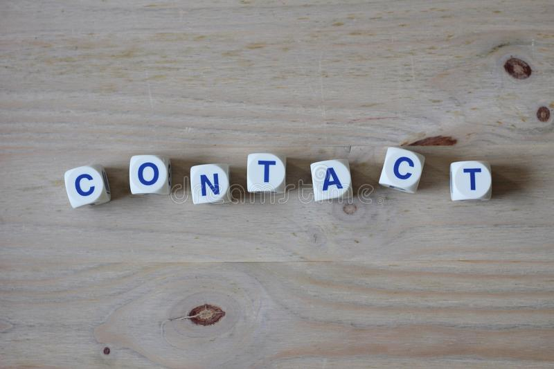 Contact. Letters cube wordings on wood background stock photo