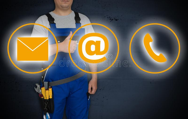 Contact options and craftsman with thumbs up stock image