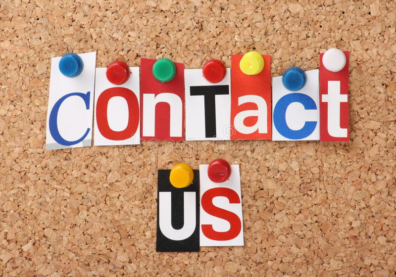 Contact Us. The words Contact Us in cut out magazine letters pinned to a cork notice board royalty free stock photos