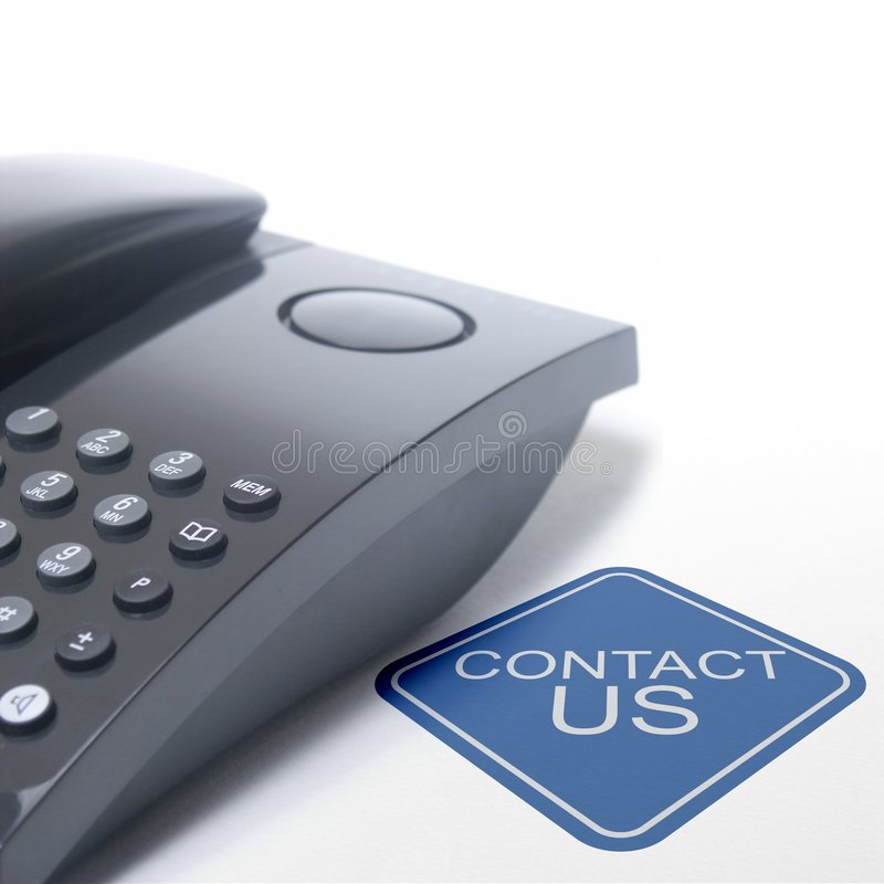 Contact us. Black telephone isolated on a white background with the sign contact us