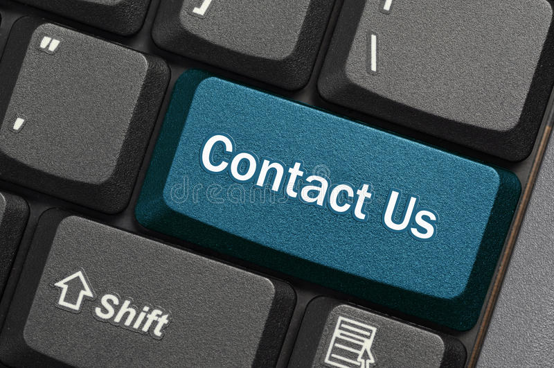 Contact us. Blue key on laptop