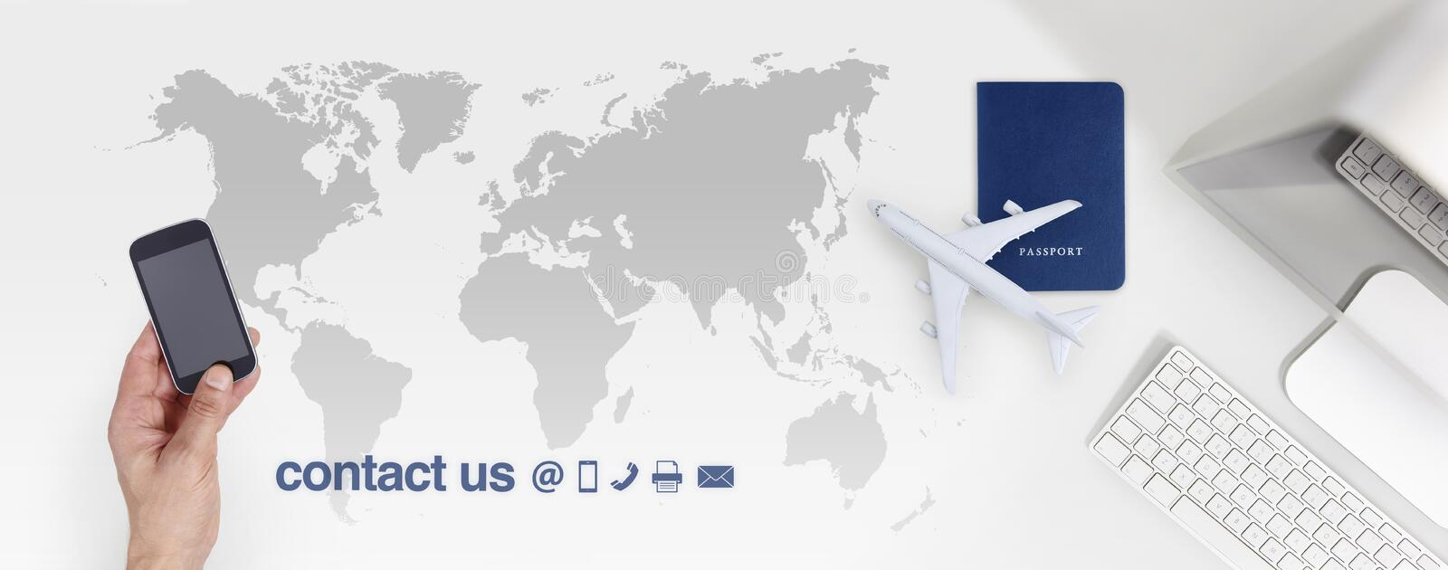 contact us and booking flight ticket air travel vacations concept, hands with smart phone on world map background stock image