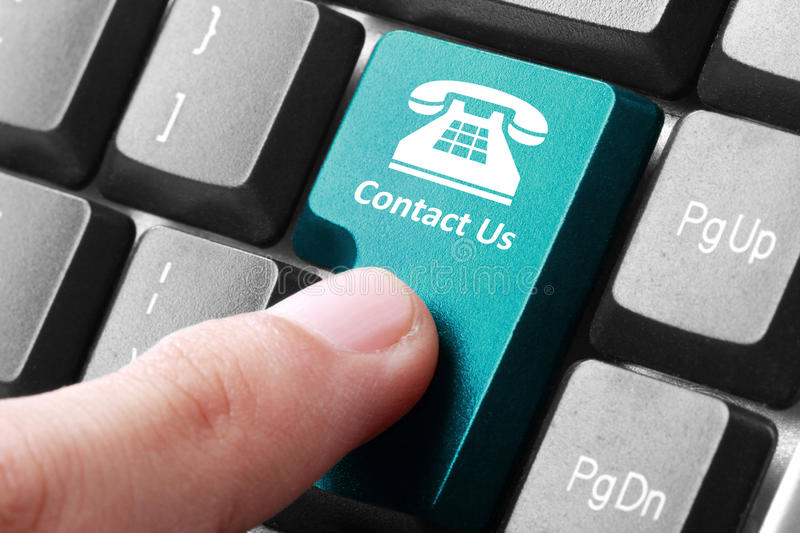 Contact us button on the keyboard royalty free stock image
