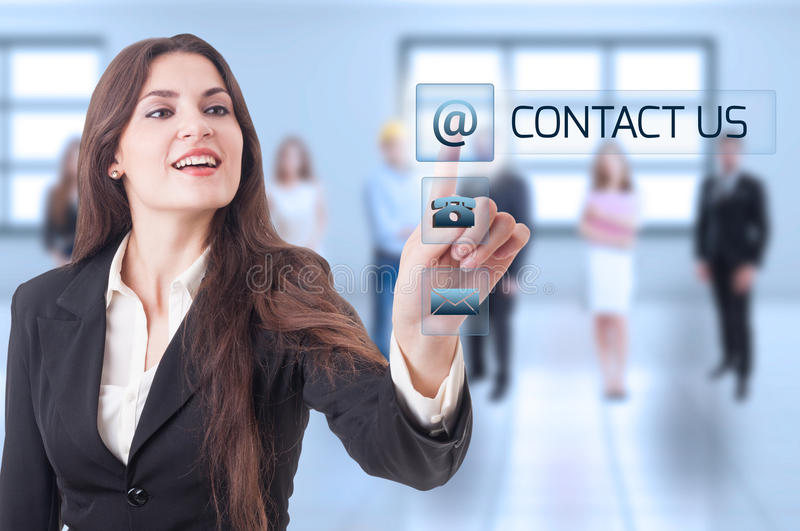 Contact us concept with business woman pressing transparent futu royalty free stock images