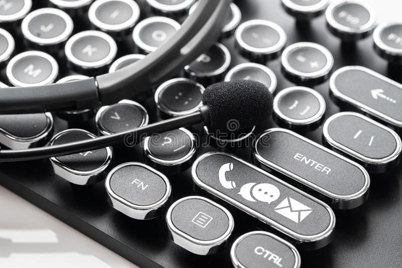 Contact us icon with headphone & microphone retro style. In studio royalty free stock photography