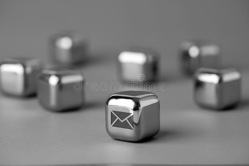 Contact us icon on metal cube for futuristic style. Lighting in studio stock images