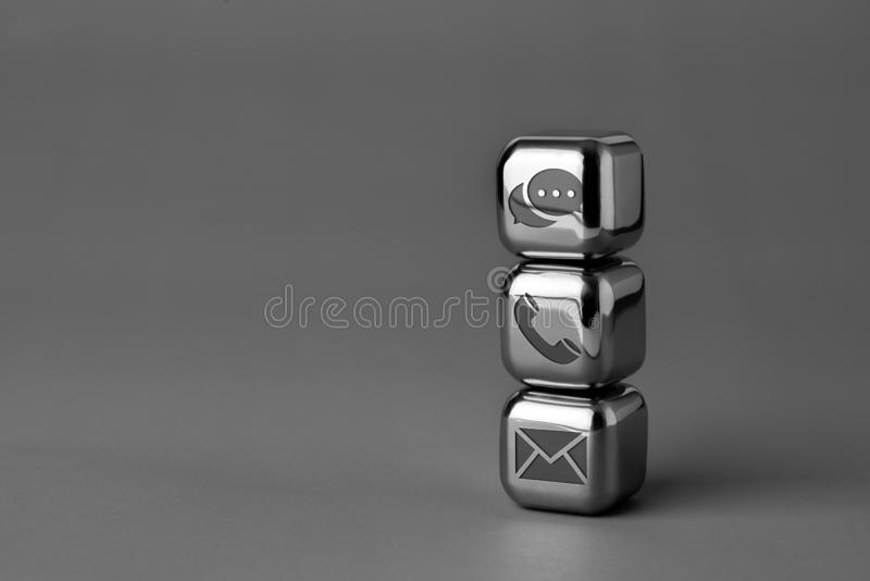 Contact us icon on metal cube for futuristic style. Lighting in studio royalty free stock photography