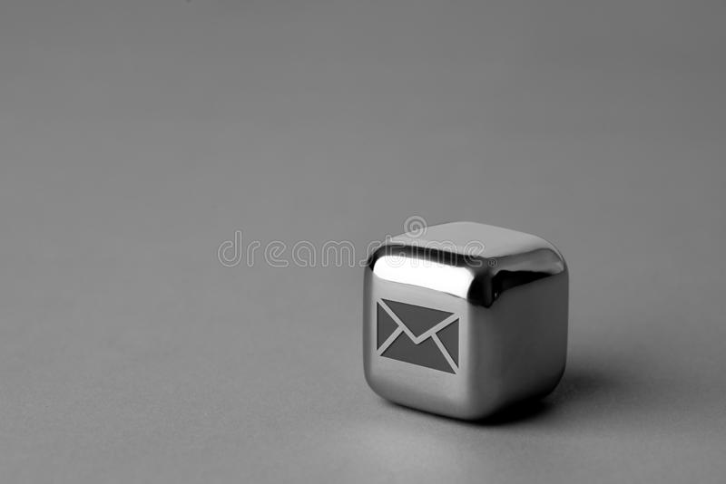 Contact us icon on metal cube for futuristic style. Lighting in studio stock photo
