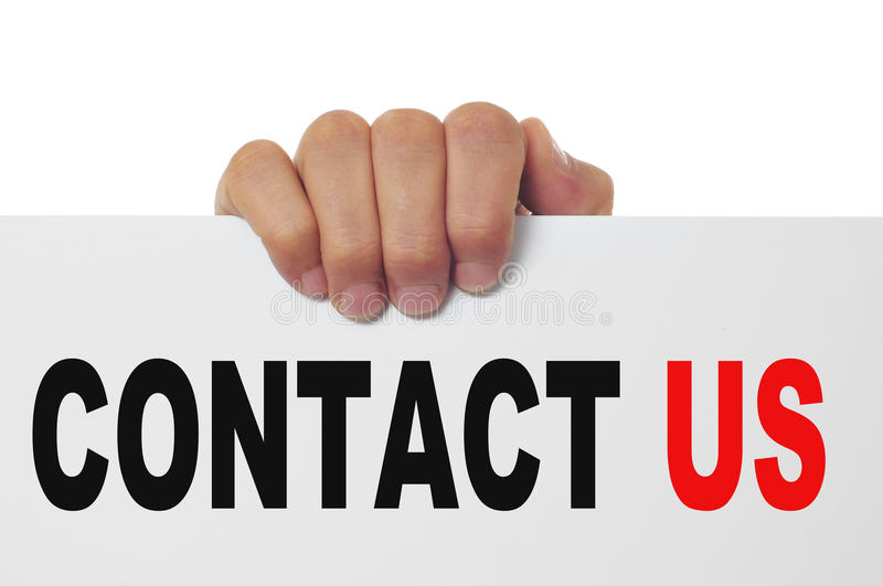 Contact us. Man hand holding a signboard with the text contact us written in it royalty free stock photo